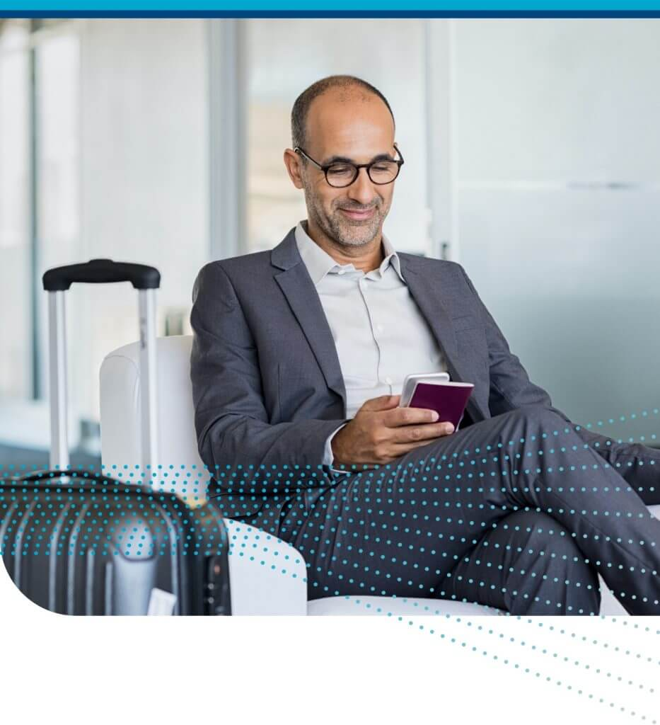 Corporate Traveler Reads Business Travel News on Mobile Phone