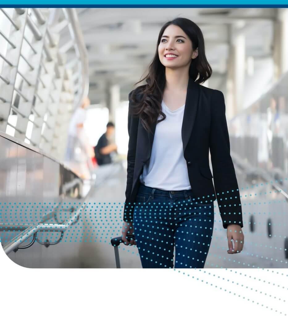 Business Traveler Walks Through Airport Using Corporate Travel Services