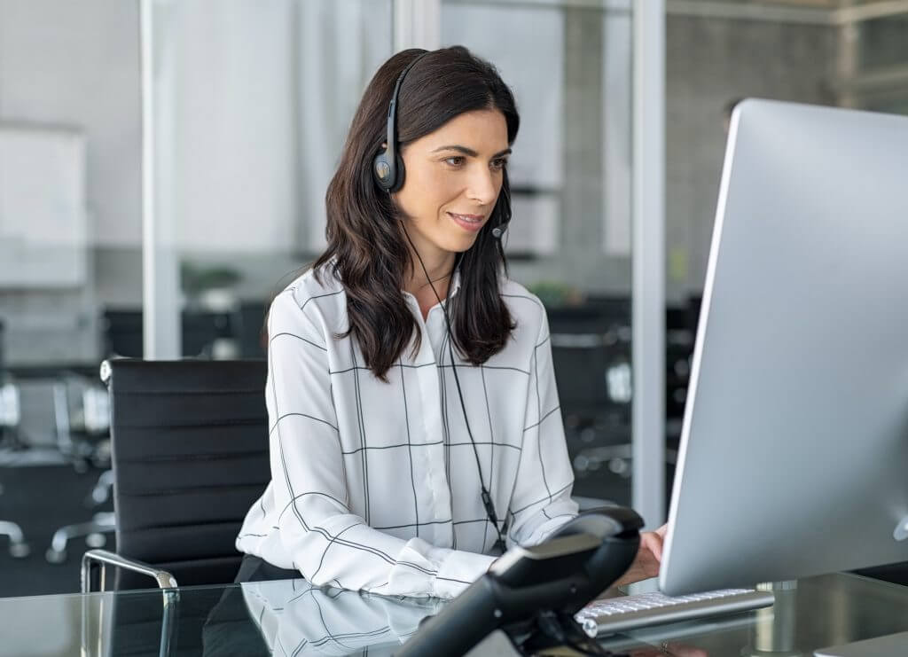Business Travel Agent with Headset booking Corporate Travel