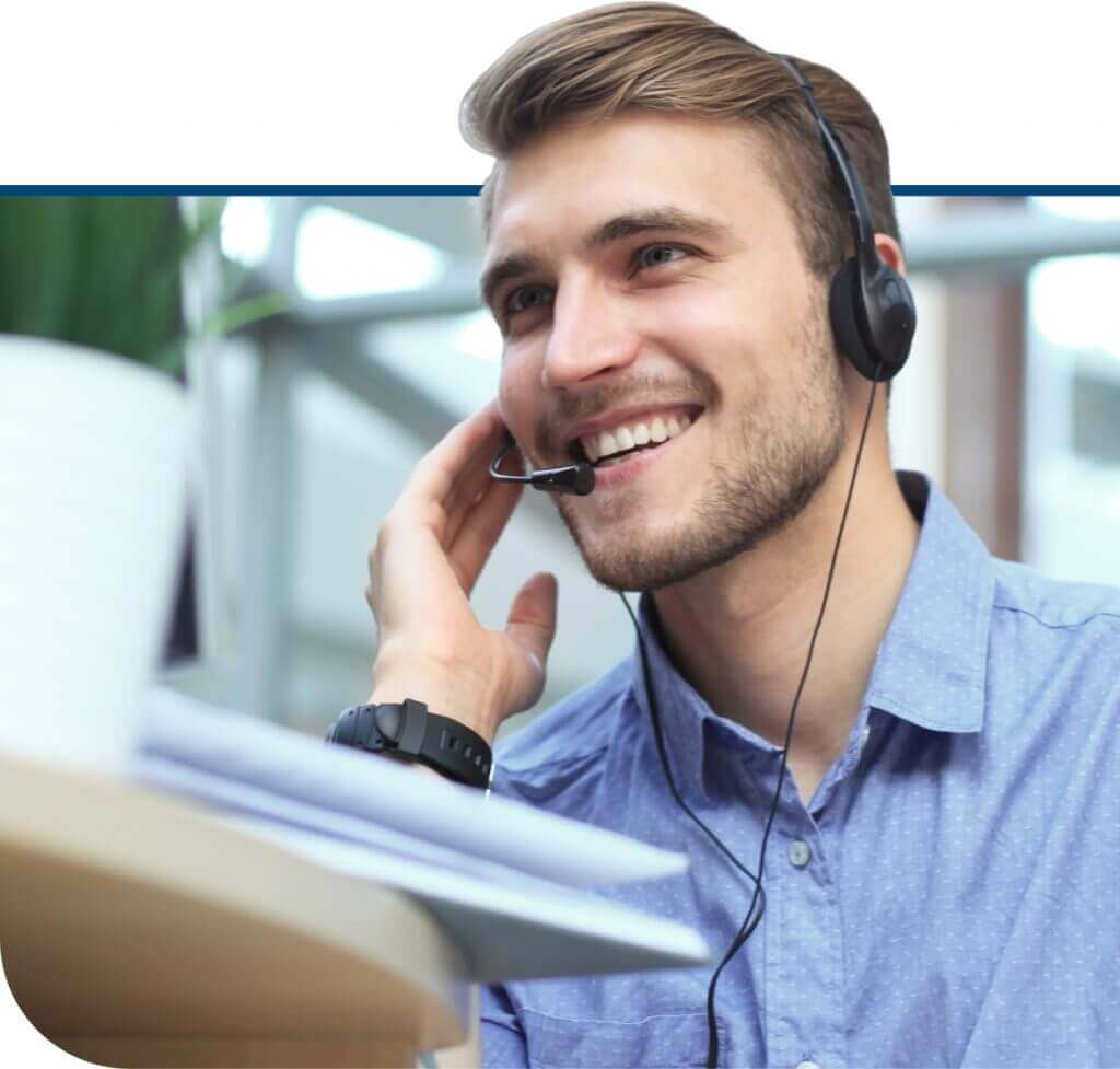 Corporate Travel Agent - Man with Headset helping customers with Corporate Travel