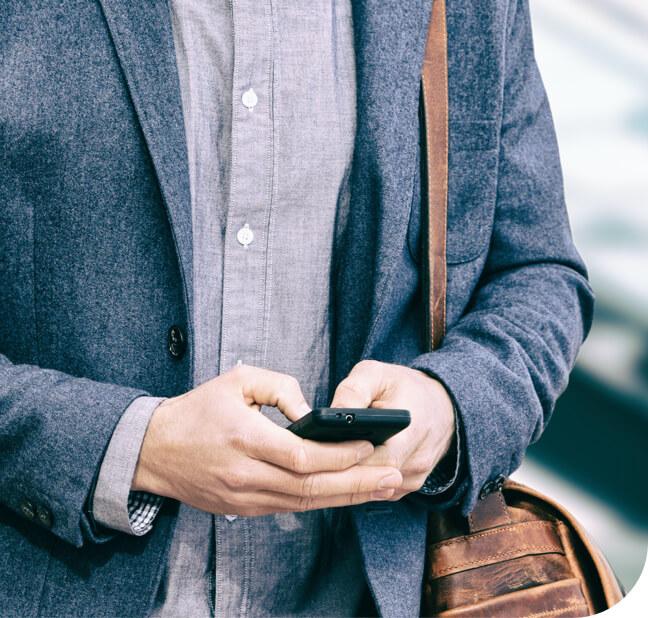 Business Traveler Uses Travel Technology on Cellphone