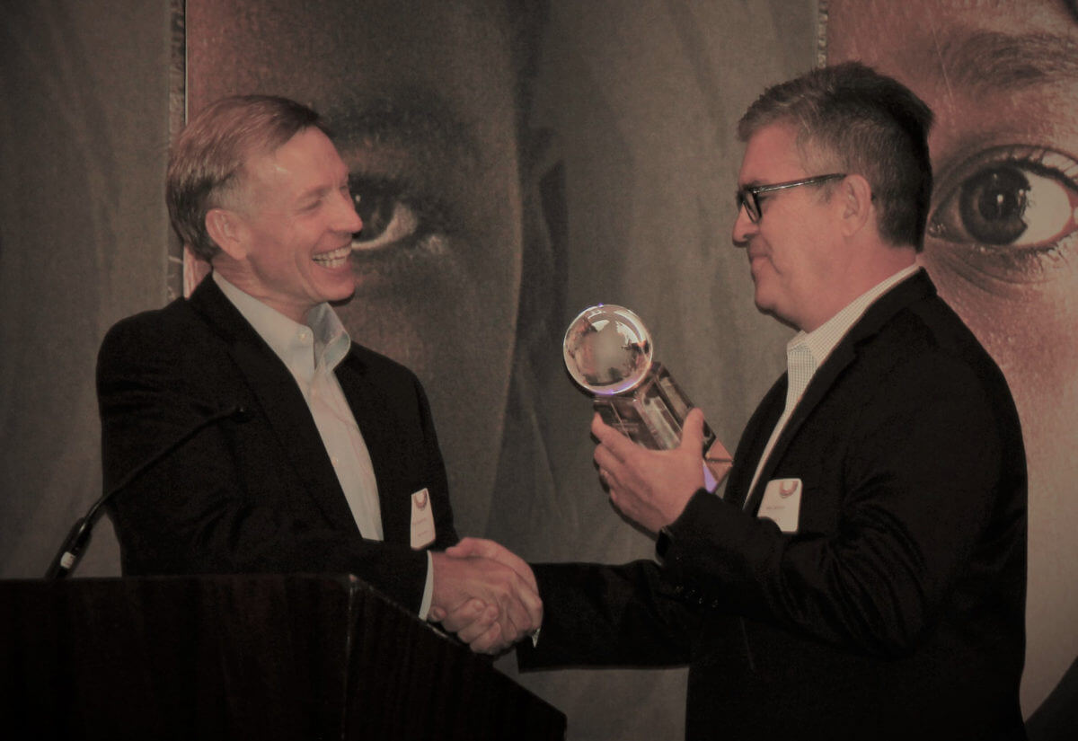 Man from CB Travel accepting an award